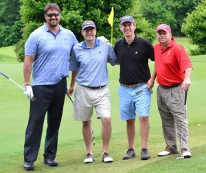 """Team Carruthers & Roth, P.A.""  at the 2013 RMA YP Benefit Golf Tournament. Pictured (from left to right): Jim Molinaro, Weyhill Companies; Robert Young, Carruthers & Roth, P.A.; Will Sydnor, UBS; and Pat Haywood, Carruthers & Roth."